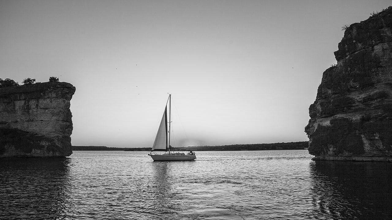 feature-water-Kenny-Braun-hells-gate-Possum-Kingdom-Lake-sailboat-sunset- Graford